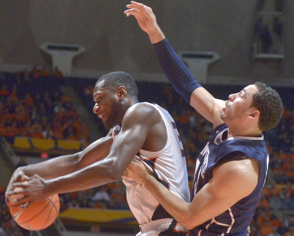 Illinois' forward/center Nnanna Egwu, left, gets a rebound in front of Penn State forward Ross Travis Saturday in Champaign.