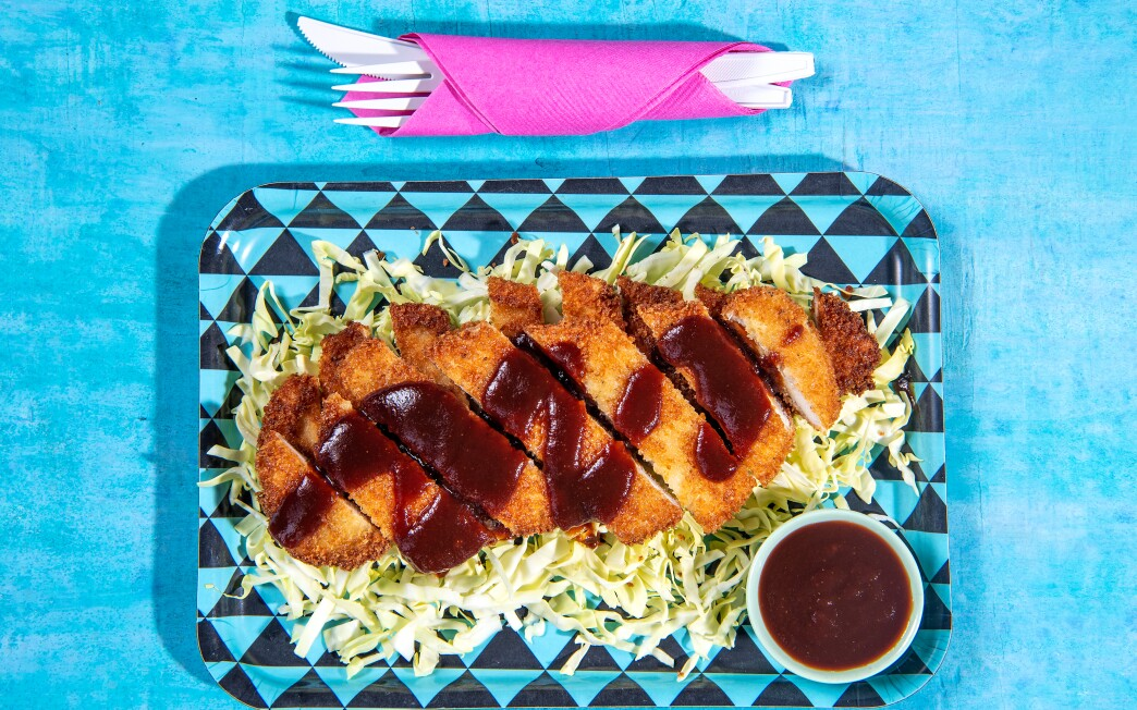 Chicken katsu is breaded and served with a tangy sauce