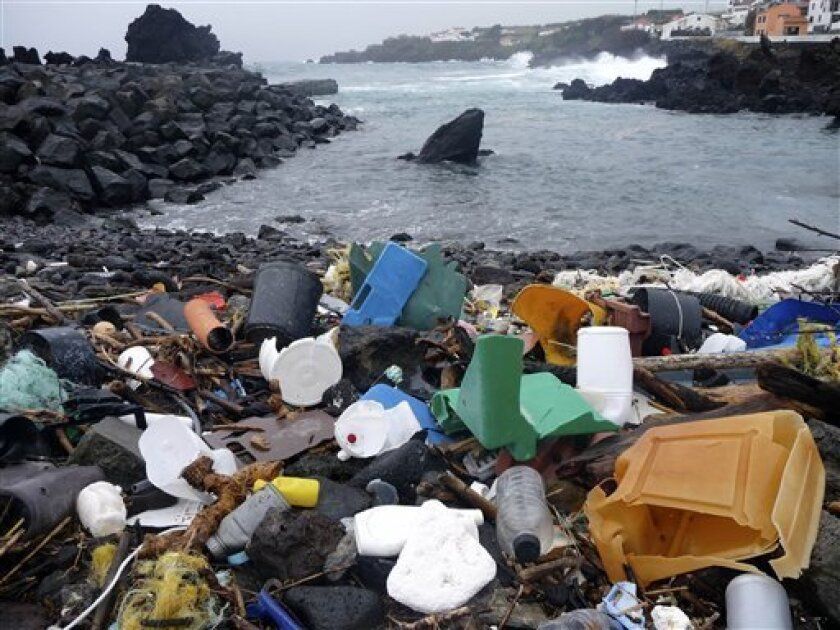 In this Feb. 15, 2010 photo released by 5 Gyres, a coastal area of the Azores Islands in Portugal, is shown littered with plastic garbage. Researchers are warning of a new blight on the North Atlantic ocean: a swirl of confetti-like plastic bits, bottle caps and other refuse stretching for thousand