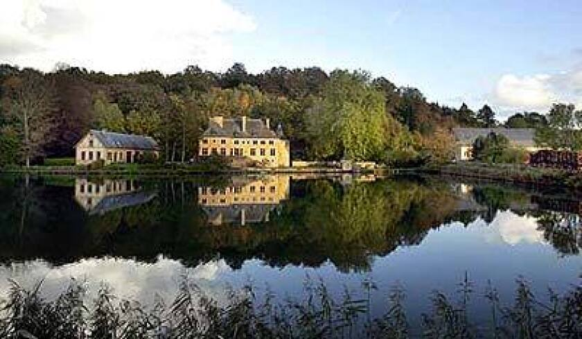 The Semois River pools in front of a chateau near the Abbey of Orval in southern Belgium.