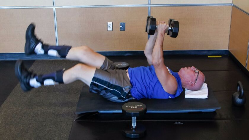 Vista resident Bob Hartdegen works out with weights five days a week at 24-Hour Fitness gym in Vista. It helps him manage the effects of Charcot-Marie-Tooth disease, a neurological disorder that affects the legs and arms.