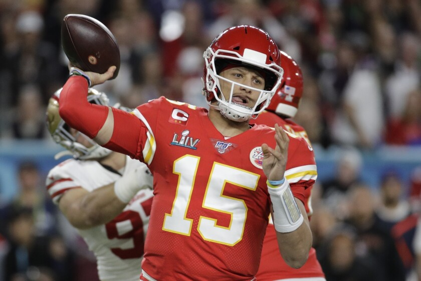 FILE - In this Feb. 2, 2020, file photo, Kansas City Chiefs quarterback Patrick Mahomes (15) passes against the San Francisco 49ers during the first half of the NFL Super Bowl 54 football game in Miami Gardens, Fla. The Chiefs have agreed to a 10-year contract extension with Super Bowl MVP Mahomes keeping him around through 2031. The Chiefs had Mahomes under contract for the next two seasons but wanted a long-term deal in place with the quarterback who led them to their first championship in 50 years. ESPN.com reported the deal is worth $450 million with an injury guarantee of $140 million. (AP Photo/Patrick Semansky, File)