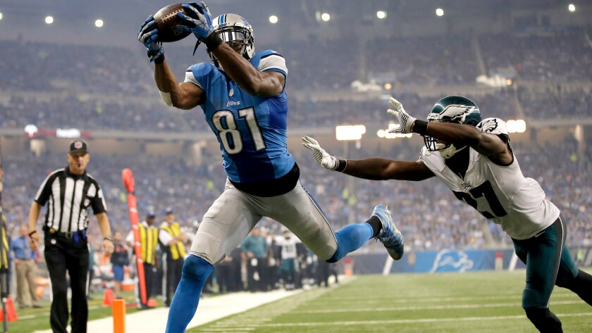 Lions begin Thanksgiving with parade of TDs in rout of Eagles