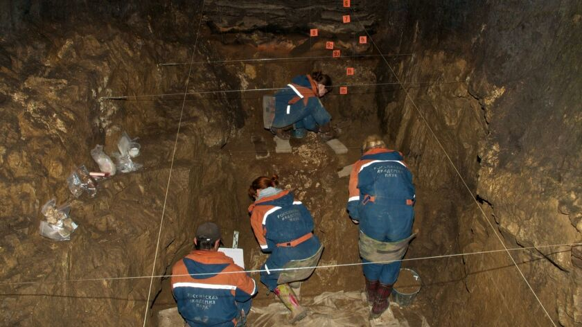 """Research team visiting Denisova Cave (""""Characteristic Features of the Middle to Upper Palaeolithic T"""