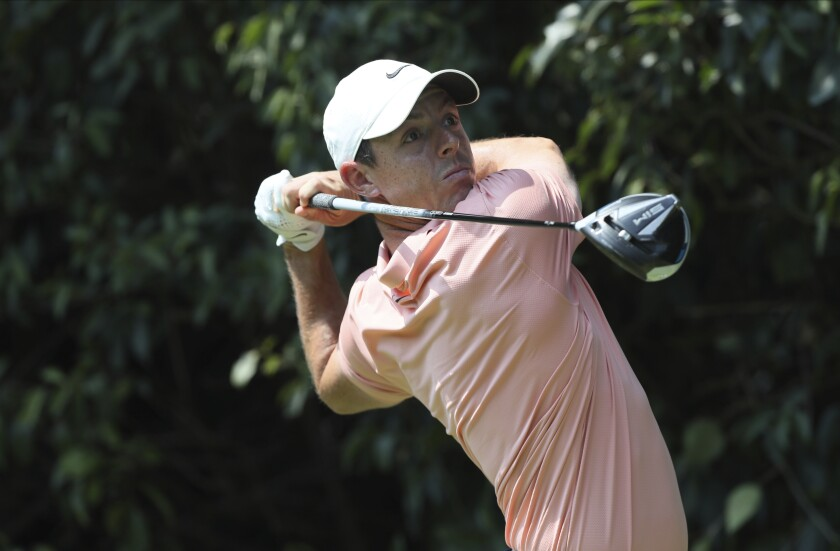 Rory McIlroy of Northern Ireland follows his tee off at the second during the final round for the WGC-Mexico Championship golf tournament, at the Chapultepec Golf Club in Mexico City, Sunday, Feb. 23, 2020.(AP Photo/Fernando Llano)