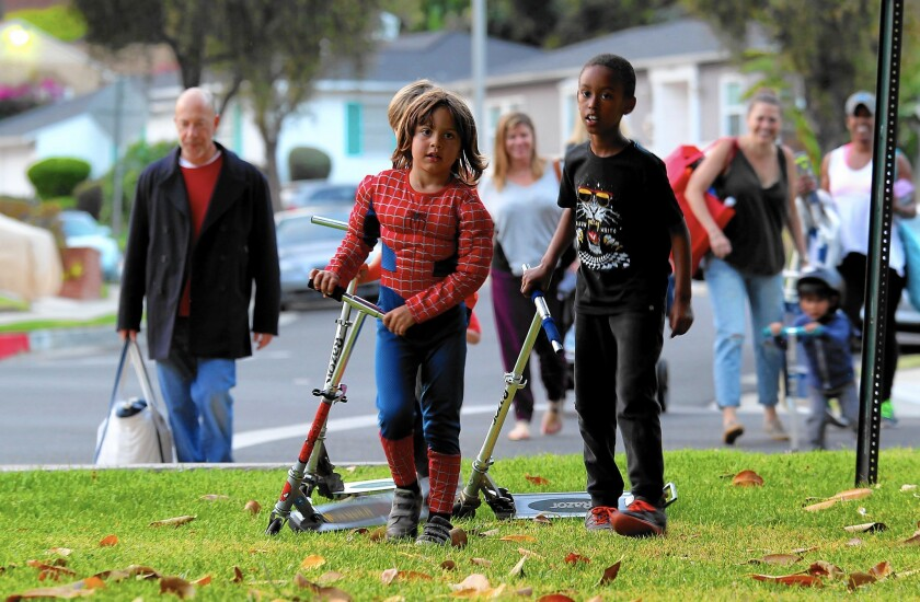 """View Park residents walk to Monteith Park for a twilight showing of the movie """"The Wiz."""""""