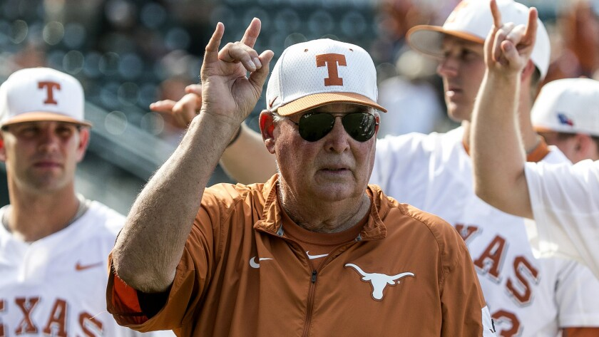 """Texas baseball coach Augie Garrido joins his players in singing the """"Eyes of Texas"""" following a game against Baylor."""