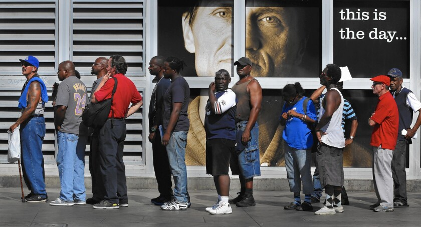 People line up for a skid row homeless court and citation clinic organized by City Atty. Mike Feuer. Participants could have tickets, fines and warrants dismissed in exchange for community service or enrollment in drug counseling or other programs.