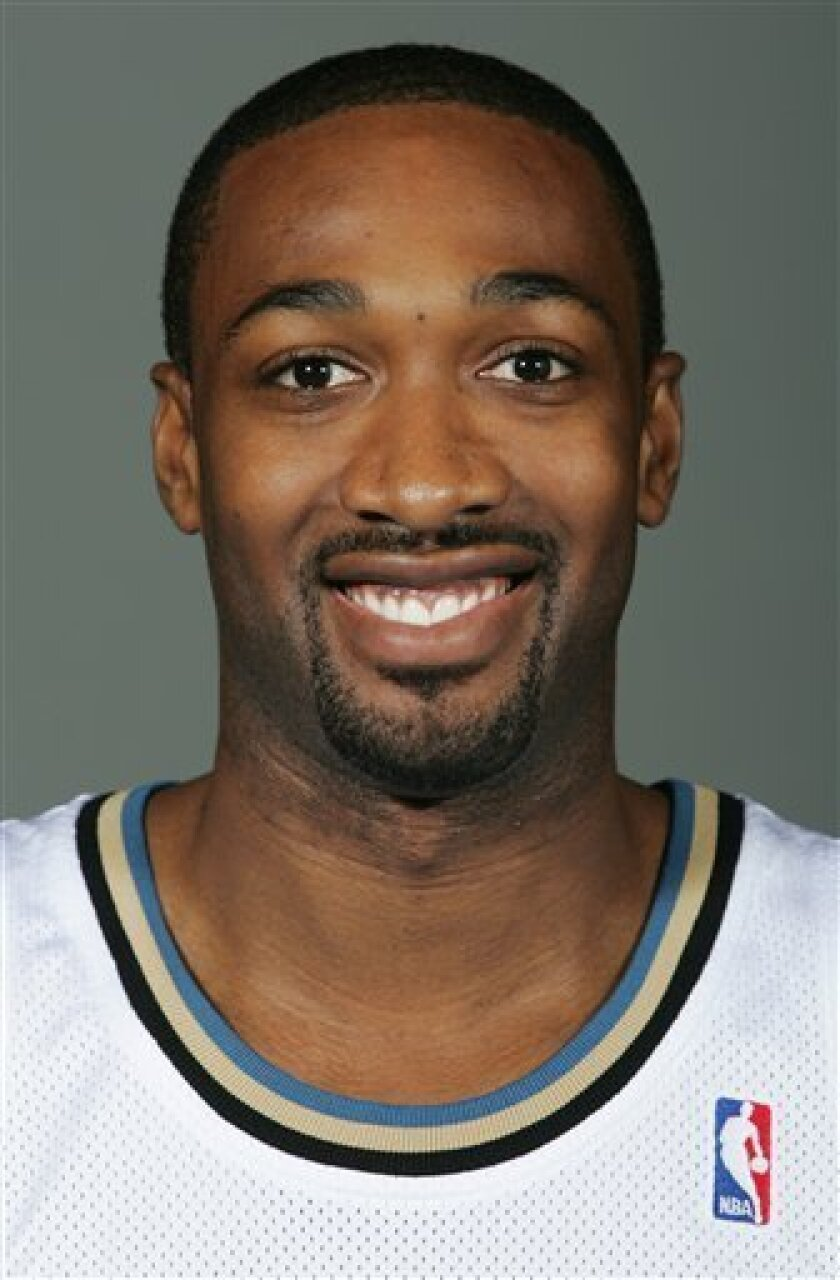 FILE - In this Sept. 26, 2008 file photo, Washington Wizards' Gilbert Arenas is shown NBA basketball media day for the Wizards in Washington. Wizards teammates Gilbert Arenas and Javaris Crittenton drew guns on each other during a Christmas Eve locker room argument over a gambling debt, according to The New York Post. Citing an anonymous source, the newspaper reports in it's Friday, Jan. 1, 2010, edition that the standoff was sparked when Crittenton became angry at Arenas for refusing to make good on a gambling debt. (AP Photo/Haraz N. Ghanbari, File)