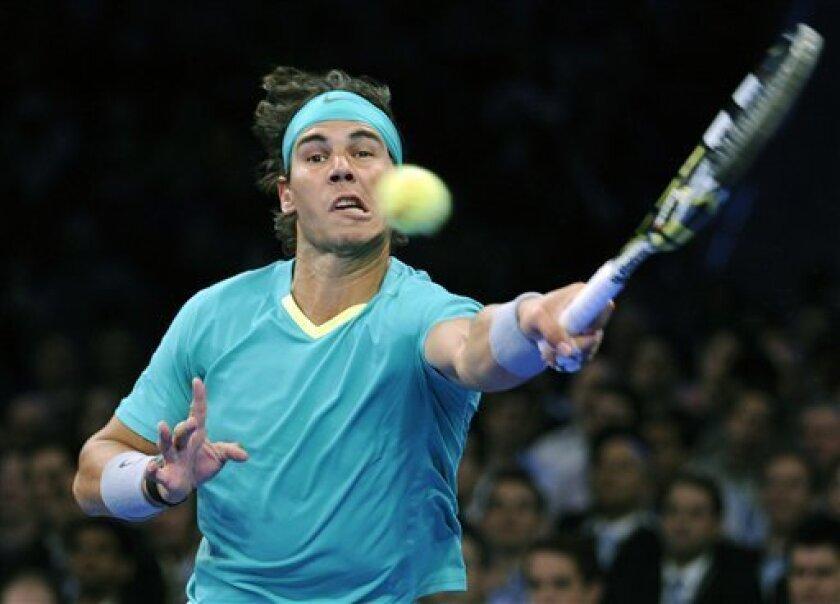Rafael Nadal, of Spain, returns the ball to Juan Martin del Potro, of Argentina, during the BNP Paribas Showdown exhibition tennis match Monday, March 4, 2013, at Madison Square Garden in New York.  (AP Photo/Bill Kostroun)