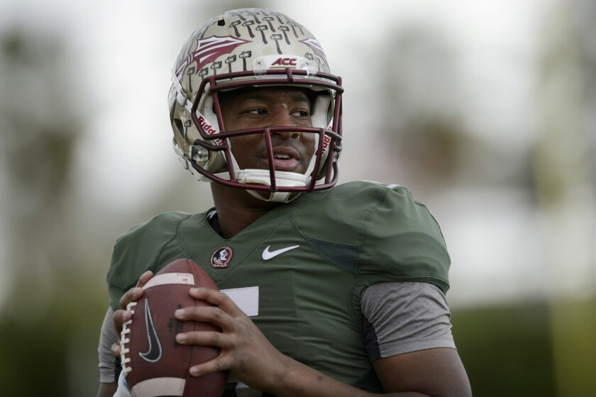 Florida State quarterback Jameis Winston throws the ball to warm up during an NCAA college football practice in Carson, Calif., Tuesday, Dec. 30, 2014. Florida State is scheduled to play Oregon in the Rose Bowl NCAA college football playoff semifinal on New Year's Day. (AP Photo/Kelvin Kuo)