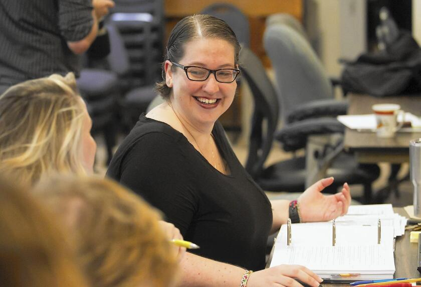 """Stage manager Talia Krispel works with the staff and actors of """"A Christmas Carol"""" in the rehearsal room of South Coast Repertory in Costa Mesa."""