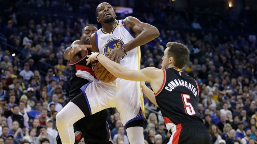 Golden State Warriors' Kevin Durant (35) is fouled against the Portland Trail Blazers during the sec