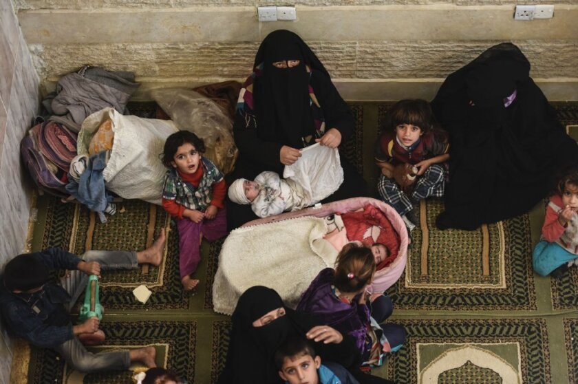 Iraqi civilians take refuge near Mosul as fighting rages around them. Russia compares the U.S.-backed Mosul offensive to its own actions in Aleppo, Syria.