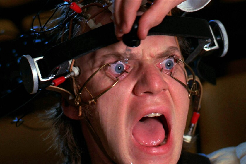 """Malcolm McDowell's eyes are mechanically held open in a scene from the movie """"A Clockwork Orange"""" (1971)."""