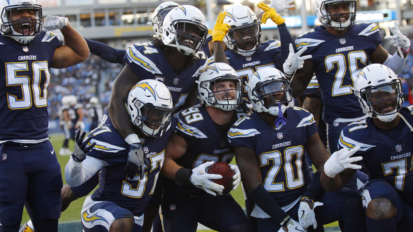 Los Angeles Chargers Joey Bosa (99) celebrates with the defense after he recovered a fumble by Oakland Raiders Marshawn Lynch at the Stubhub Center in Carson on Dec. 31, 2017. (Photo by K.C. Alfred/ San Diego Union-Tribune)