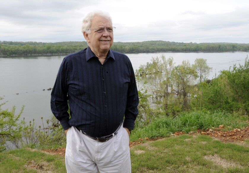 Jimmy Johnson outside his home on the Tennessee River in Sheffield, Ala., in 2015.