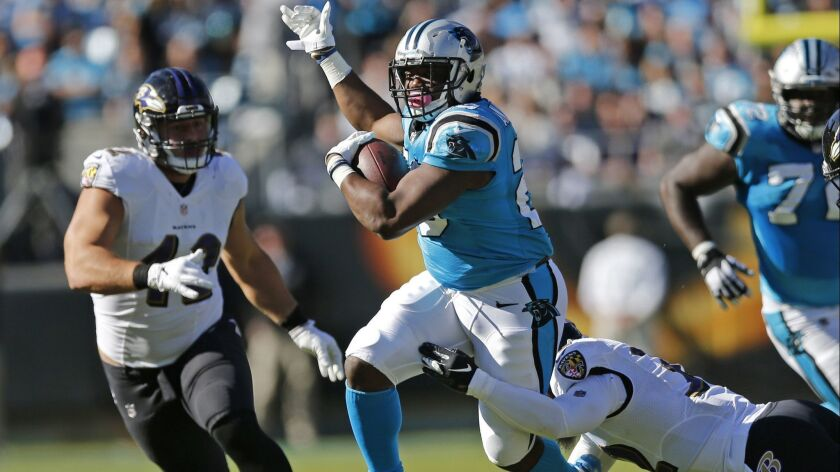 FILE - In this Sunday, Oct. 28, 2018 file photo, Carolina Panthers' C.J. Anderson (20) runs as Balti