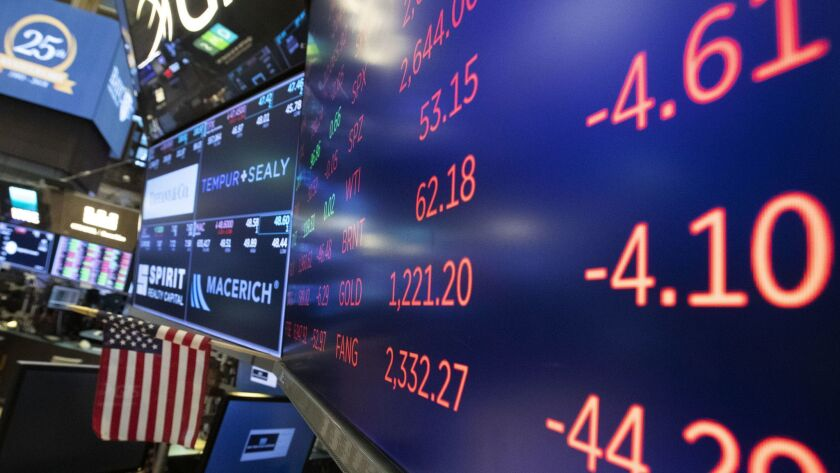 Stock screens are displayed, Tuesday, Nov. 20, 2018, at the New York Stock Exchange. Stocks are skid