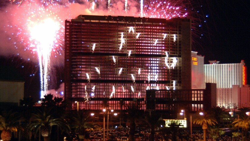 As fireworks light the night sky, the Stardust resort is reduced to rubble by explosives on March 13, 2007. It was one of two Strip hotels to be imploded that year.