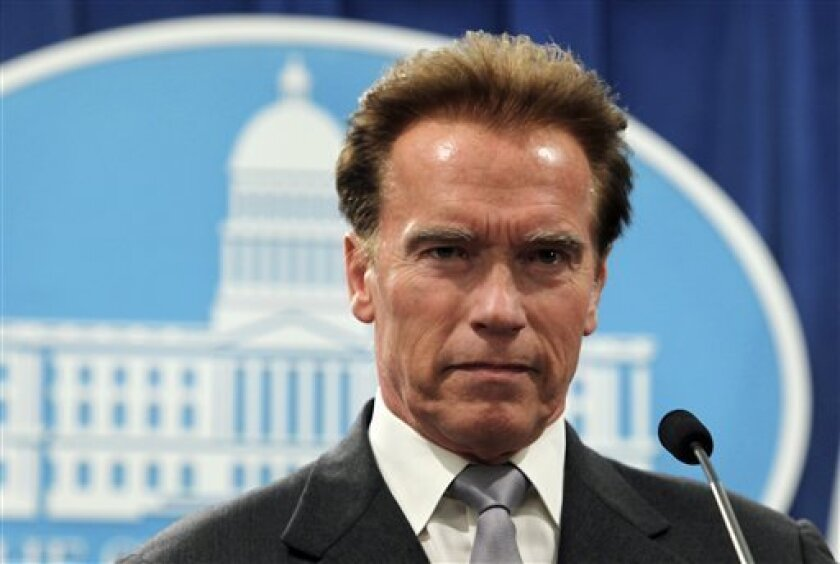 Gov. Arnold Schwarzenegger listens to a reporter's question during a news conference at the Capitol in Sacramento, Calif., Wednesday, Jan. 7, 2009. Schwarzenegger said he will restart stalled state budget talks in hopes of getting an agreement to deal with a $42 billion deficit.  (AP Photo/Rich Ped