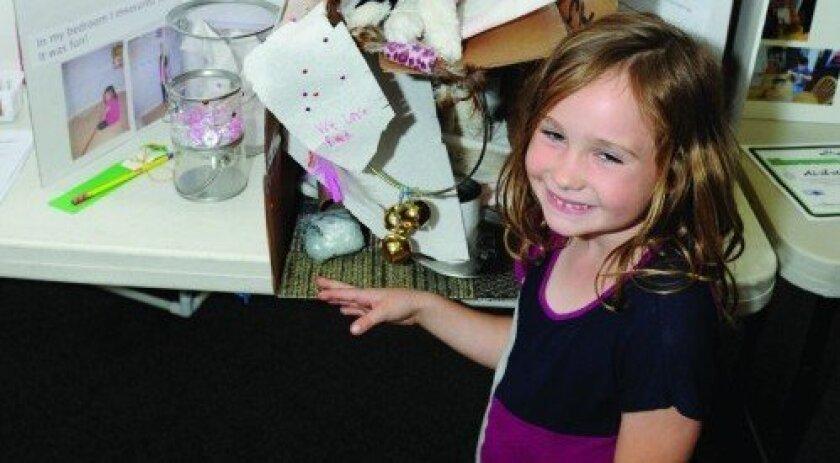 "Torrey Hills kindergartner Lauren Kate Panebianco with her invention ""Kitty Condo"" (Photo: Jon Clark)"