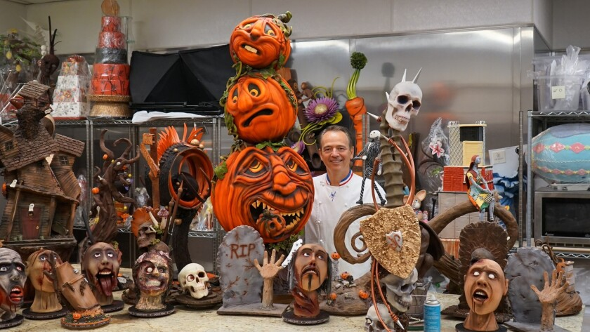 Jean-Philippe Maury and his team have created dozens of ghoulish but tasty Halloween treats. The creations crafted from chocolate and fondant icing include a zombie, carved pumpkins and skulls.