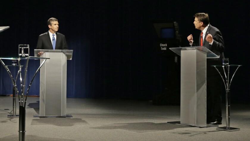 North Carolina Republican Gov. Pat McCrory, right, debates with Democratic challenger Atty. Gen. Roy Cooper on Oct. 11.