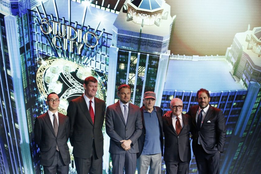 Melco Crown Entertainment co-chairman and chief executive Lawrence Ho and co-chairman James Packer pose with film stars Leonardo DiCaprio, Robert De Niro, director Martin Scorsese and producer Brett Ratner during a launch ceremony of the Studio City project in Macau.