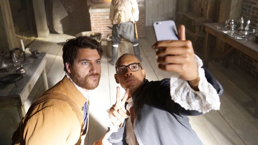 """Time travelers Adam Pally and Yassir Lester take a selfie in colonial Massachusetts in """"Making History,"""" premiering Sunday on Fox."""