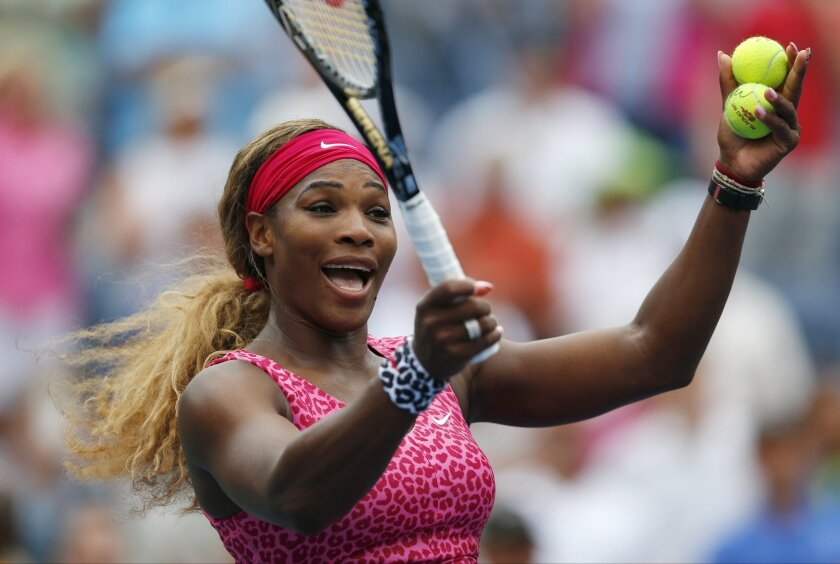 Serena Williams, of the United States, reacts to the crowd as she prepares to hit balls into the stands after defeating Varvara Lepchenko, of the United States, during the third round of the 2014 U.S. Open tennis tournament, Saturday, Aug. 30, 2014, in New York. (AP Photo/Matt Rourke)
