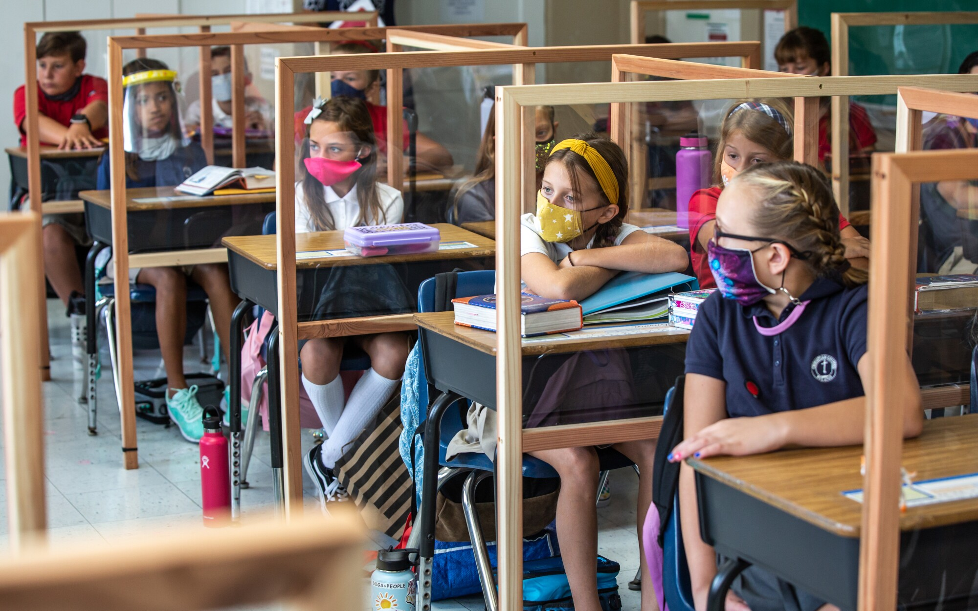 Plexiglass dividers separate students desks at Christian Unified East elementary school in El Cajon on Monday.