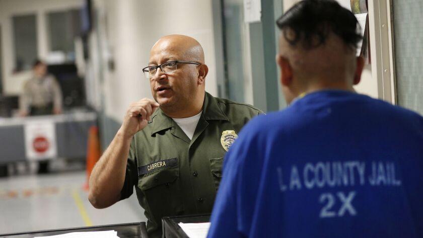 LOS ANGELES, CA - MAY 13, 2019 - Los Angeles County Sheriff Custody Assistant Rodolfo Cabrera, left,