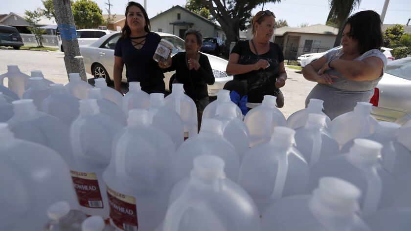 COMPTON, CALIF. - JUNE 19, 2018. Compton rsidents pick up supplies of donated bottled water from a