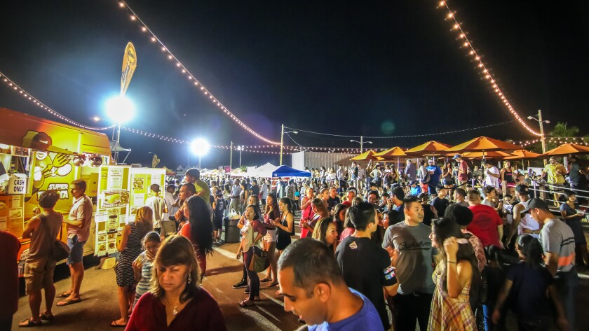 Tents and trucks draw crowds along Honolulu's waterfront. The cheap eats are offered Monday-Saturday.
