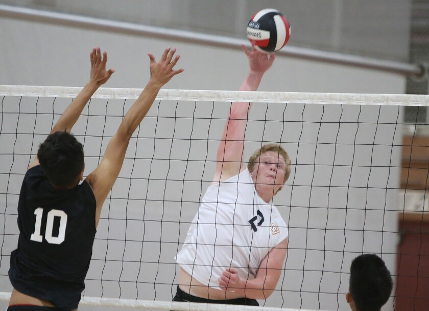 Ocean View's Hunter Miller, right, hits the ball past Johnny Zavala (10) for a point during Golden W