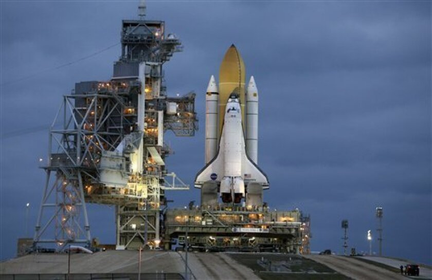 Space shuttle Discovery arrives at pad 39A for launch preparations after a six hour journey from the Vehicle Assembly Building at the Kennedy Space Center in Cape Canaveral, Fla., Wednesday, March 3, 2010. Discovery is targeted for launch April 5 on a mission to the International Space Station.(AP Photo/John Raoux)