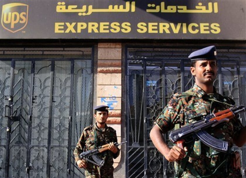 Armed Yemeni police stand guard by closed UPS office Thursday, Nov. 4, 2010, in San'a, Yemen. One of two mail bombs sent from Yemen last week was disarmed just 17 minutes before it was set to go off, the French interior minister said Thursday. (AP Photo/Hasan Jamali)
