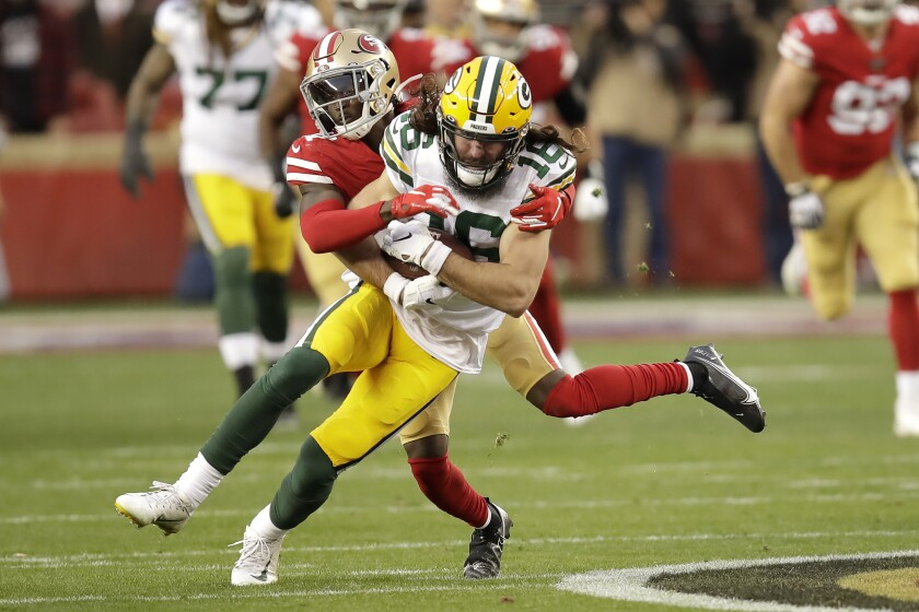 FILE - In this Jan. 19, 2020, file photo, Green Bay Packers wide receiver Jake Kumerow (16) is tackled by San Francisco 49ers defensive back Emmanuel Moseley during the first half of NFL football's NFC championship game in Santa Clara, Calif. The Packers cut Kumerow, offensive lineman Alex Light and linebacker Tim Williams among others as they got their roster down to the 53-man limit before their Sept. 13 opener at Minnesota. (AP Photo/Ben Margot, File)