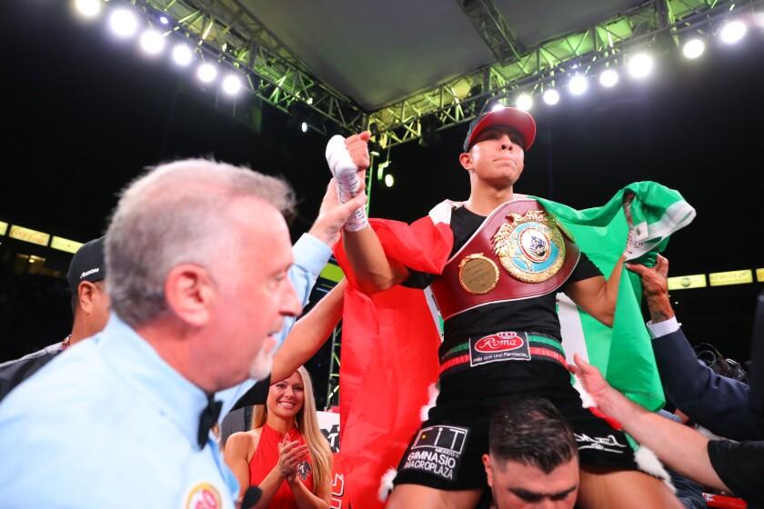 Jaime Munguia celebrates his super welterweight victory over Patrick Allotey.