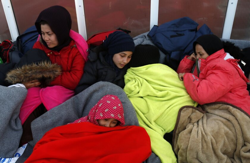 Migrants rest at the train station in Sid, about 100 km west from Belgrade, Serbia, Wednesday, Feb. 17, 2016. More than 200 people have been camping at a border train station after they were sent back to Serbia from Croatia amid tightened rules for migrants seeking entry into the European Union. (A