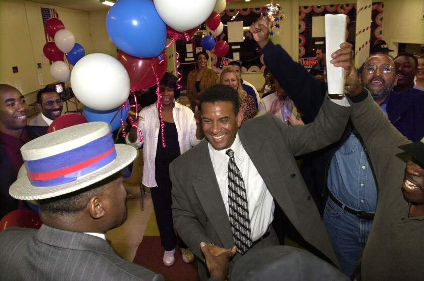 Councilman Terry Johnson celebrates with his supporters after winning the Oceanside mayoral election.