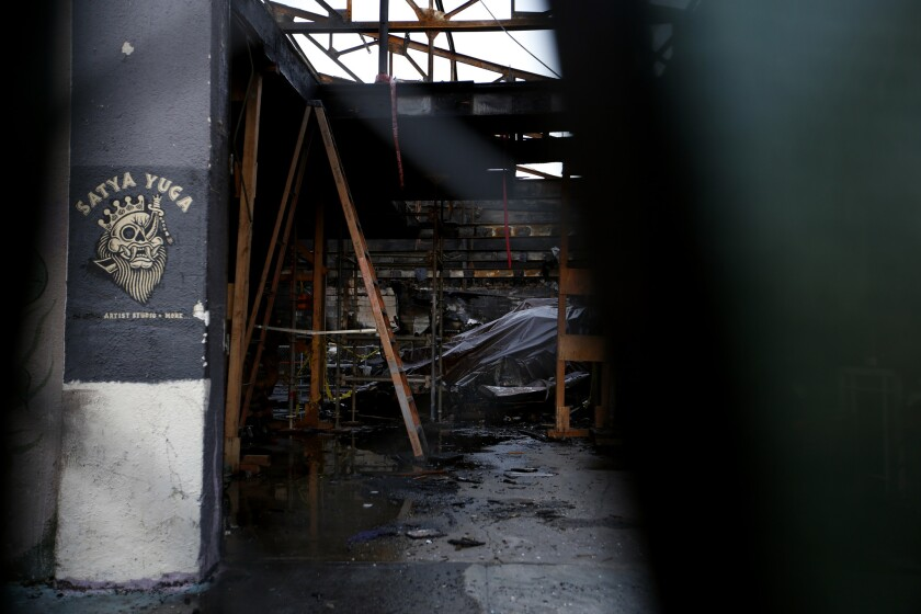 A view through the fence around the Ghost Ship warehouse following the December 2016 fire