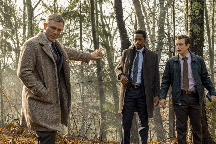 "Daniel Craig, from left, Lakeith Stanfield and Noah Segan in ""Knives Out."""