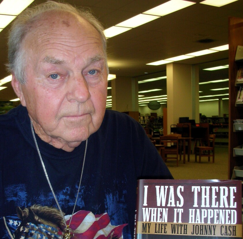 "Marshall Grant poses with a copy of his book, ""I Was There When It Happened: My Life with Johnny Cash,"" in 2007."