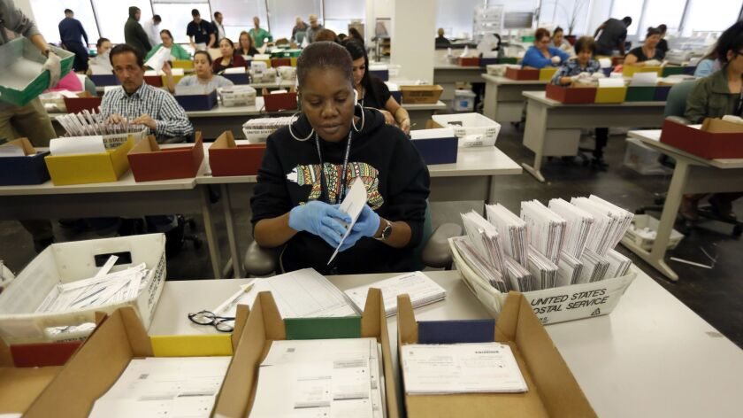 NORWALK, CA NOVEMBER 13, 2018: Workers at the Los Angeles County Registrar-Recorder/County Clerk a