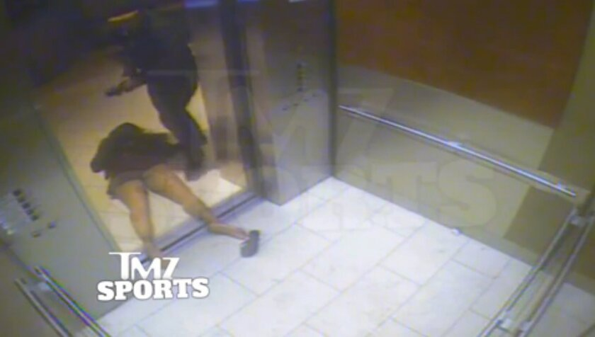"FILE - In this February 2014 file photo, from a still image taken from a hotel security video released by TMZ Sports, Baltimore Ravens running back Ray Rice drags his fiancee, Janay Palmer, out of an elevator moments after knocking her off her feet, against the elevator's railing at the Revel casino in Atlantic City, N.J. A law enforcement official says he sent a video of Ray Rice punching his then-fiancee to an NFL executive five months ago, while league officers have insisted they didn't see the violent images until this week. The person played The Associated Press a 12-second voicemail from an NFL office number on April 9 confirming the video arrived. A female voice expresses thanks and says: ""You're right. It's terrible."" (AP Photo/File)"