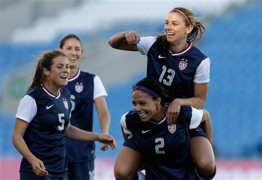 Alex Morgan, of the US celebrates on the shoulders of Sydney Leroux after scoring the opening goal against Germany during their Algarve Cup women's soccer final match Wednesday, March 13 2013, at the Algarve stadium outside Faro, southern Portugal. The US defeated Germany 2-0 in the final. (AP Photo/Armando Franca)