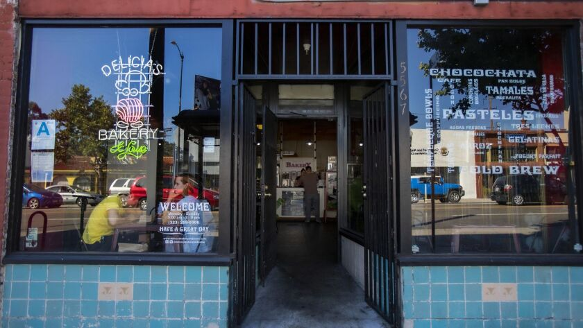 HIGHLAND PARK, CA - JUNE 8, 2019: Customers sit in the cafe window enjoying fresh Pan Dulce at Deli