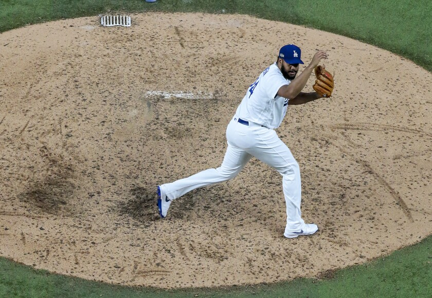 Dodgers relief pitcher Kenley Jansen delivers a pitch during the ninth inning of a 3-1 win over the Atlanta Braves.